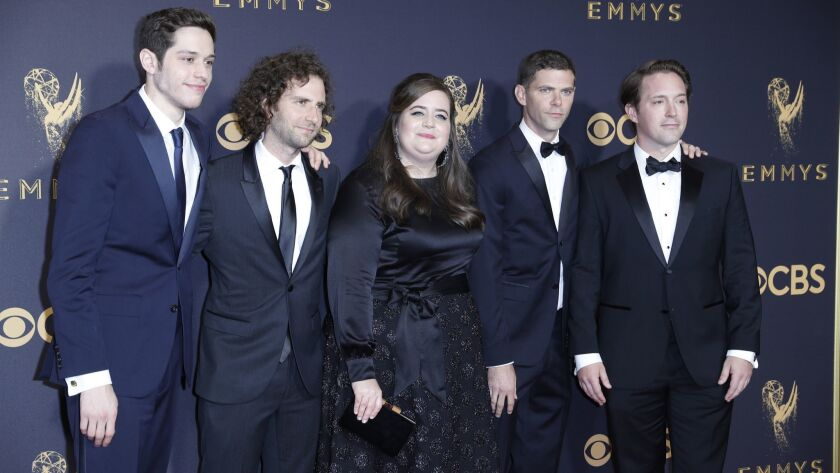 "Actress Aidy Bryant, center, with Pete Davidson, far left, Kyle Mooney, Mikey Day, right, and Beck Bennett, of ""Saturday Night Live."""