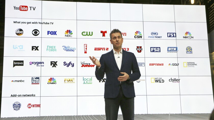 YouTube Chief Business Officer Robert Kuncl, with a graphic showing the many networks that will be carried, speaks during the introduction of YouTube TV in Playa Vista on Tuesday.