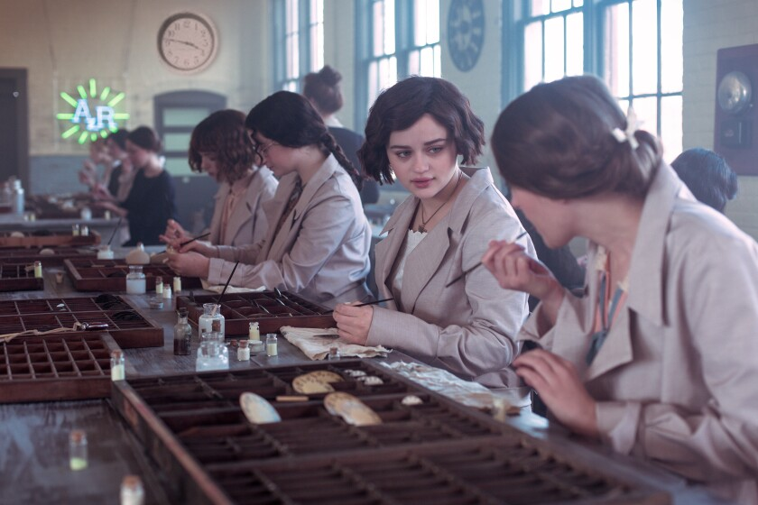"""Joey King and other women use paintbrushes in a factory in """"Radium Girls."""""""