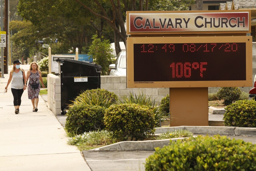 The thermometer at Calvary Church in Woodland Hills registers 106 degrees on Monday.