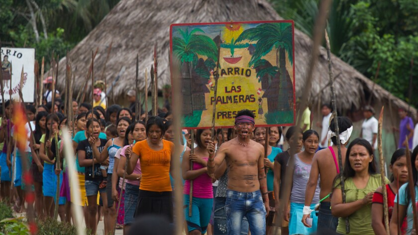 """Peru's indigenous Amazonian people protest to save their rainforest land in the documentary """"When Two Worlds Collide."""""""