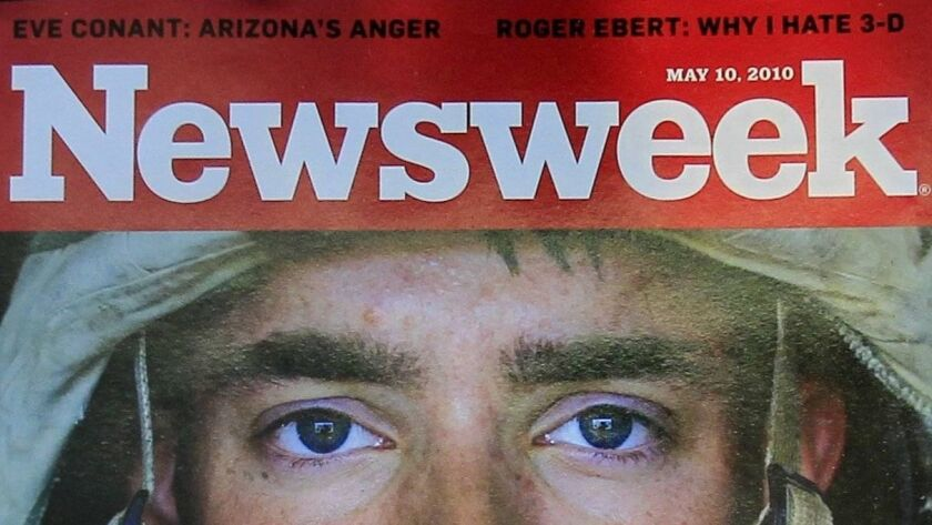 Newsweek magazine is displayed on a shelf at a news stand at South Station in Boston, Wednesday, May