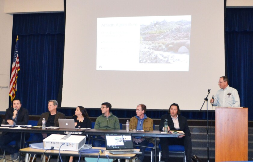 Traffic consultant Walter B. Musial, left, answers a question at the forum held March 1 on The Farm in Poway.