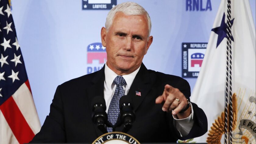 Vice President Mike Pence gestures while speaking to the Republican National Lawyers Assn. on Friday.