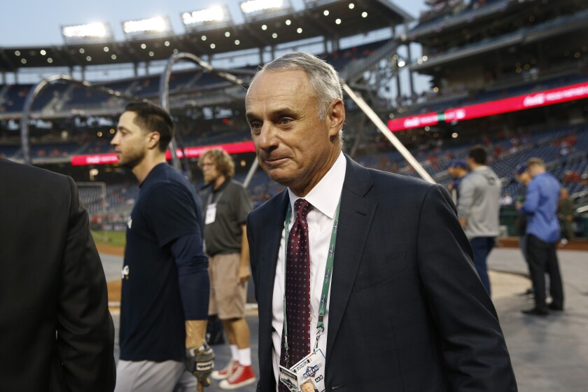 Major League Baseball Commissioner Rob Manfred walks on the field during batting practice before a National League wild-card game between the Milwaukee Brewers and the Washington Nationals on Oct. 1 in Washington.