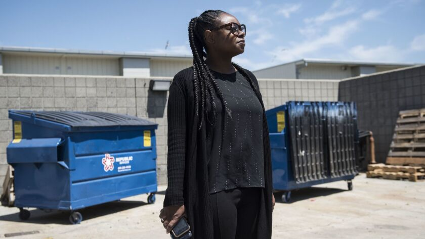 TORRANCE CA APRIL 22, 2019 -- Shandrea Daniel, principal of Magnolia Science Academy 3, stands in th