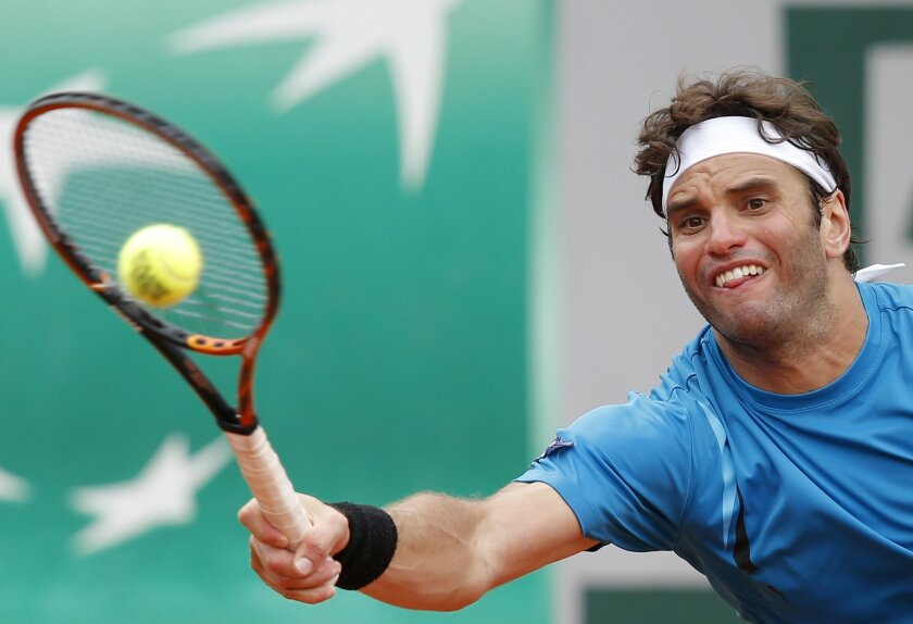 Tunisia's Malek Jaziri returns the ball to Tomas Berdych of the Czech Republic  during their second round match of the French Open tennis tournament at the Roland Garros stadium, Thursday, May 26, 2016 in Paris.  (AP Photo/Michel Euler)