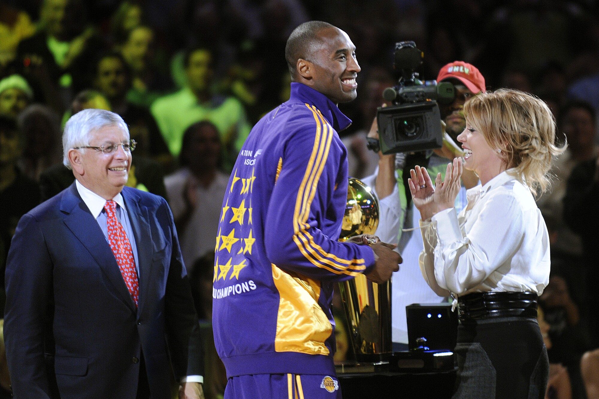 Kobe Bryant smiles after receiving his 2009 championship ring from NBA Commissioner David Stern, left, and Jeanie Buss.