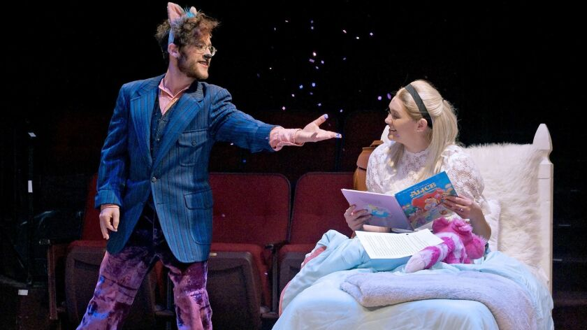 "Spencer Ty Pierson, as the Cheshire Cat, and Rebecca Thomas, as Alice, in a scene from ""Alice in Won"
