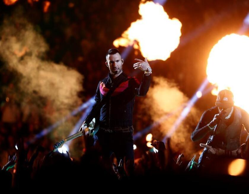 Adam Levine (L) of Maroon 5 and Travis Scott (R) perform during the halftime show of Super Bowl LIII between the New England Patriots and the Los Angeles Rams during the first half of Super Bowl LIII at Mercedes-Benz Stadium in Atlanta, Georgia, USA, Feb. 03, 2019. EPA-EFE/LARRY W. SMITH