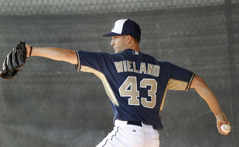 Padres pitcher Joe Wieland practices his pitches as the second day of spring training began for the Padres with pitchers and catchers.