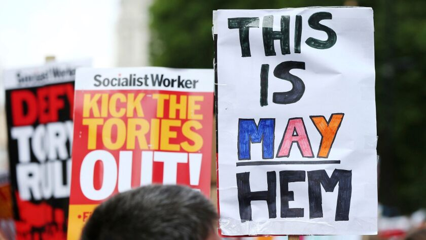 Protesters gather in Whitehall, London, to protest the Conservative government June 17 after the fir