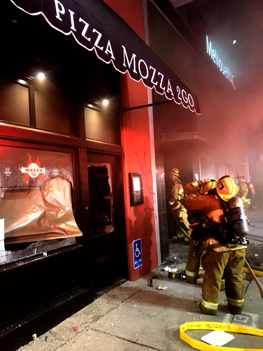 Firefighters at MelroseMac and Mozza2Go next door.