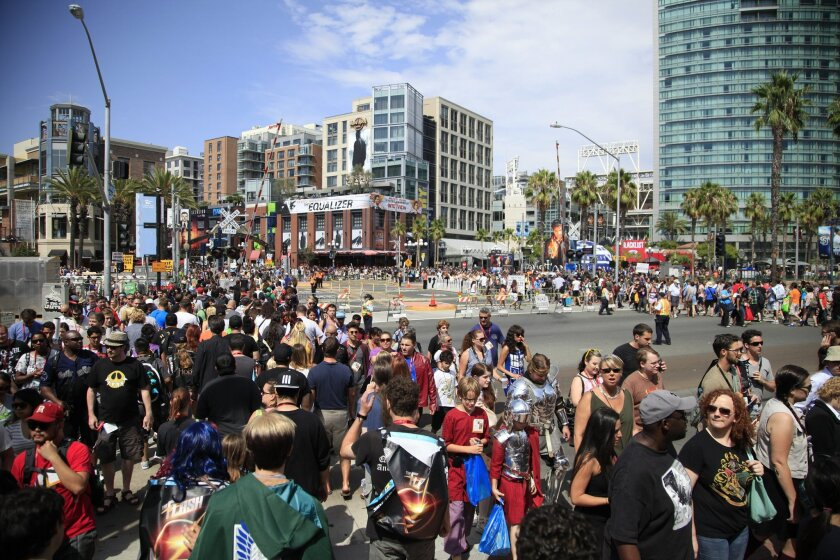July 26th, 2014 San Diego, CA- Comic Con has spilled into the streets and into the surrounding hotels as attendees cross Harbor Drive going to and from the Convention Center. Over 100 thousand visitors will pass through the convention center over the four days of the event. Photo by David Brooks/ U-T San Diego MANDATORY PHOTO CREDIT DAVID BROOKS / U-T SAN DIEGO; ZUMA Press.