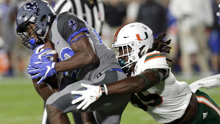 Miami's Mike Smith tries to tackle Duke's Brittain Brown during the first half of a game Sept. 29.