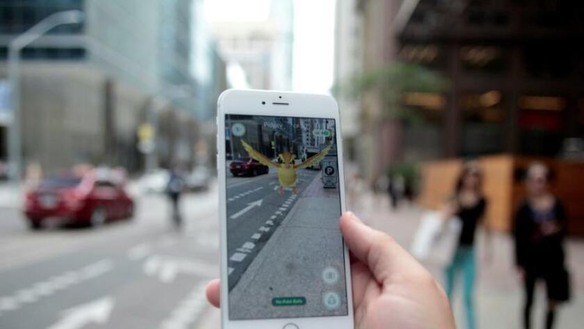 """A """"Pidgey"""" Pokemon is seen on the screen of the Pokemon Go mobile app, Nintendo's new scavenger hunt game which utilizes geo-positioning, in a photo illustration taken in downtown Toronto, Ontario, Canada July 11, 2016. REUTERS/Chris Helgren/File Photo ** Usable by SD ONLY ** (Reuters Photo)"""