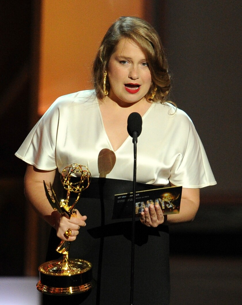 """Merrit Wever from """"Nurse Jackie"""" onstage accepting her Emmy award."""