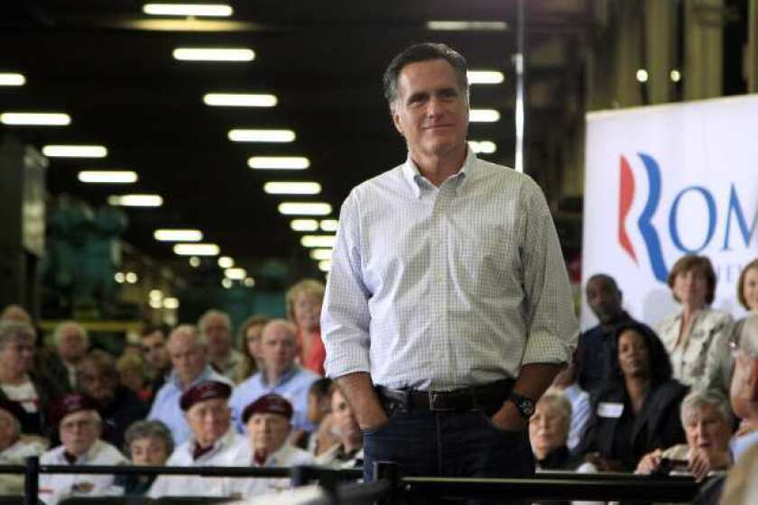 Mitt Romney listens to a question from a supporter at a town hall-style meeting in Euclid, Ohio, on Monday.