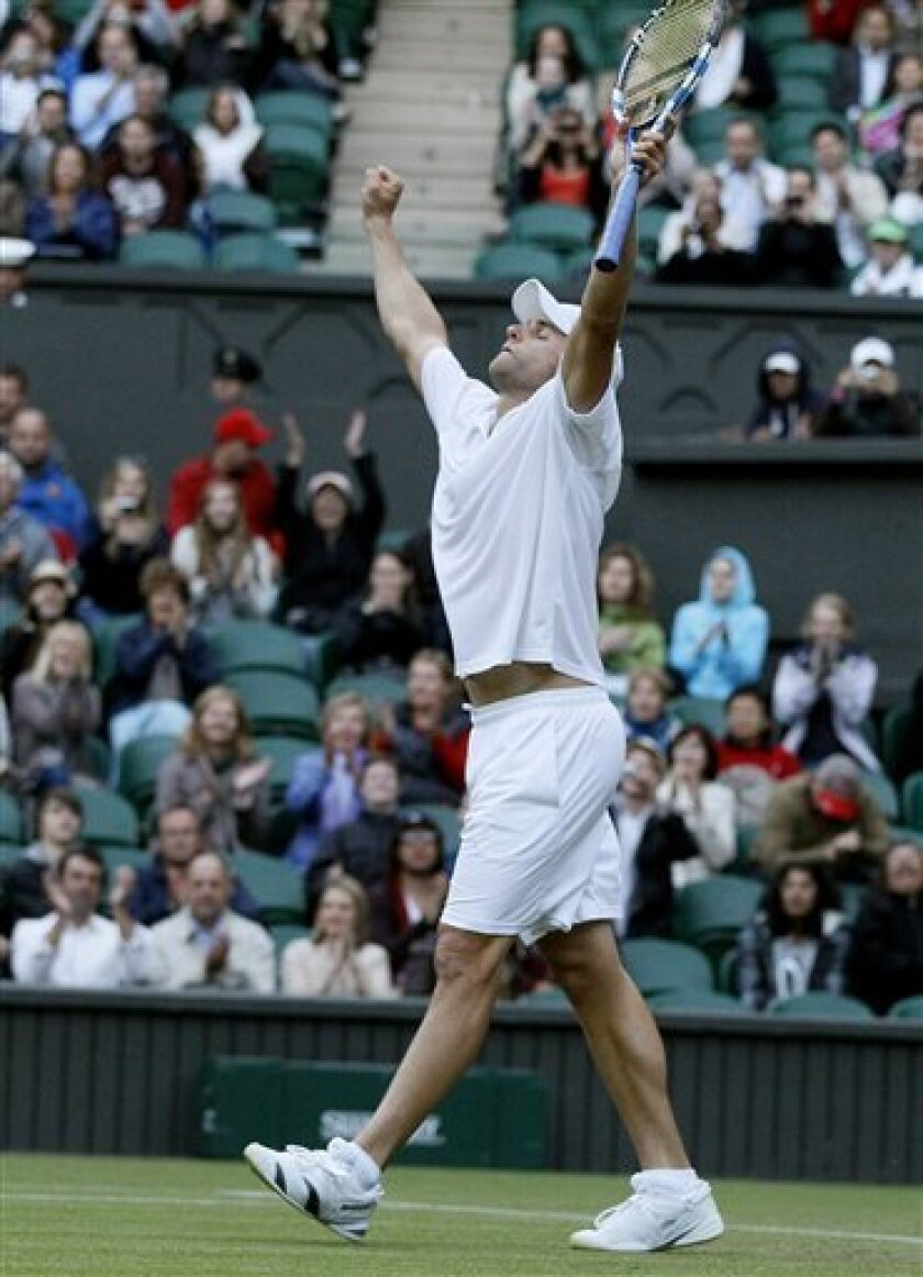 Andy Roddick of the US reacts after defeating Romania's Victor Hanescu in their match at the All England Lawn Tennis Championships at Wimbledon, Wednesday, June 22, 2011. (AP Photo/Kirsty Wigglesworth)