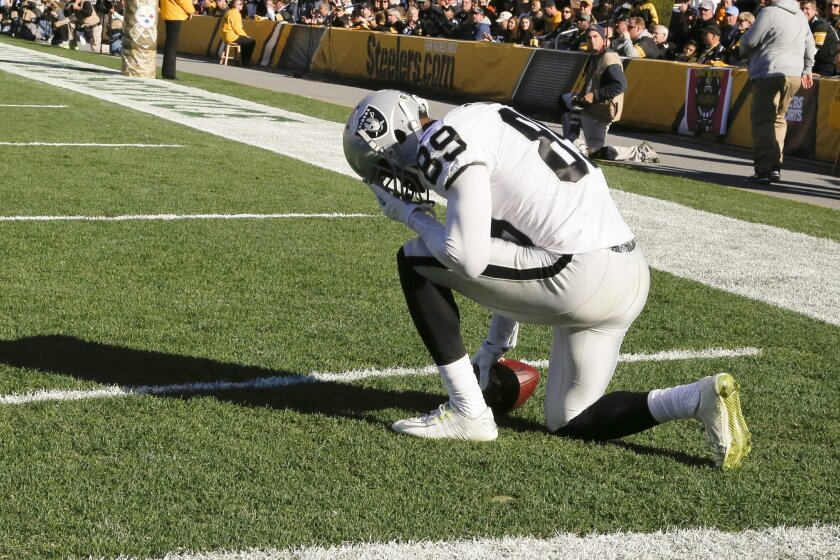 Oakland Raiders wide receiver Amari Cooper (89) kneels in the end zone after making a touchdown catch in the second quarter of an NFL football game against the Pittsburgh Steelers, Sunday, Nov. 8, 2015, in Pittsburgh. (AP Photo/Gene Puskar)