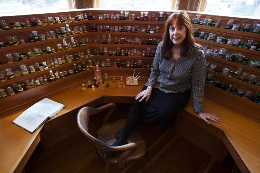 Mandy Aftel, creator of organic perfumes, sits in front of her fragrance organ in her home studio in Berkeley, where she hand-blends and bottles the fragrances in small batches.