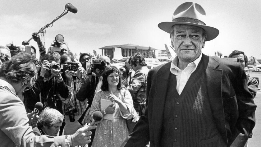 Original caption (taken from another photo from the same shoot): April 28, 1978 -- John Wayne chats