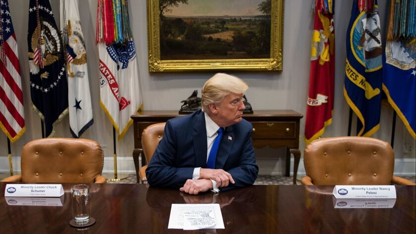 While Trump is flanked here by empty chairs to mock Democrats who boycotted a White House meeting in November, the photo could just as well be a metaphor for the record number of high-level administration jobs that are unfilled.
