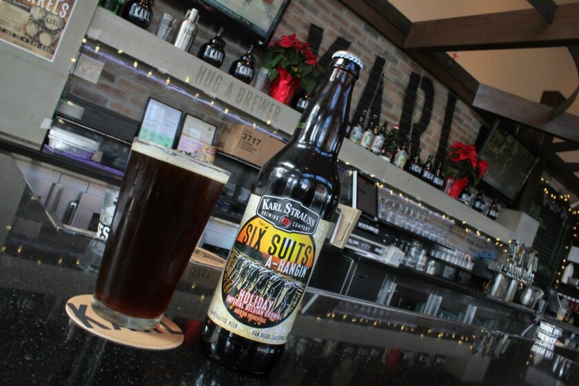 Karl Strauss has since 2010 given a name to each single beer released annually in its '12 Days of Christmas' series, putting a local spin on each of the classic Christmas song's corresponding days. This year's addition: Six Suits A-Hangin', an Imperial Belgian Brown.