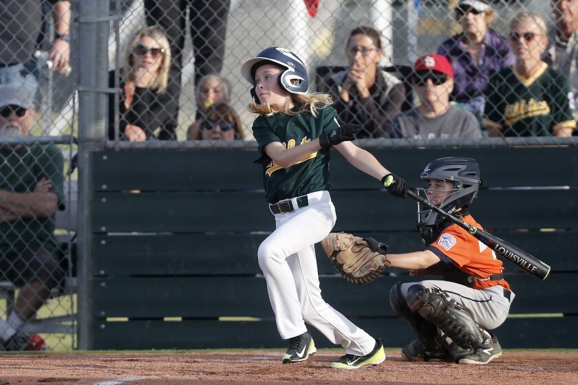 Costa Mesa American Little League No. 1 team's Bennett Molica singles in the tying the run against O