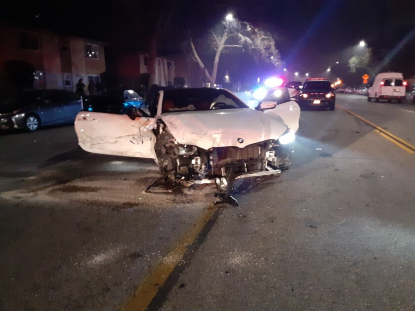 A white BMW sedan with its front end severely damaged sits in the 300 block of West Alameda Avenue after allegedly being involved in a street race on Sunday, Jan. 26, according to Burbank police.
