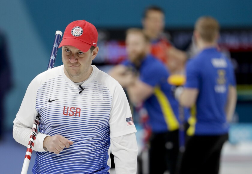 """FILE - In this Feb. 16, 2018, file photo, United States's skip John Shuster looks on during a men's curling match against Sweden at the Winter Olympics in Gangneung, South Korea. Curling is a 500-year-old sport that pairs chess-like strategy with furious sweeping and shouts of """"Hurry Hard,"""" and is considering radical rule changes as it tries to balance centuries of tradition with the modern need to move things along. (AP Photo/Natacha Pisarenko, File)"""