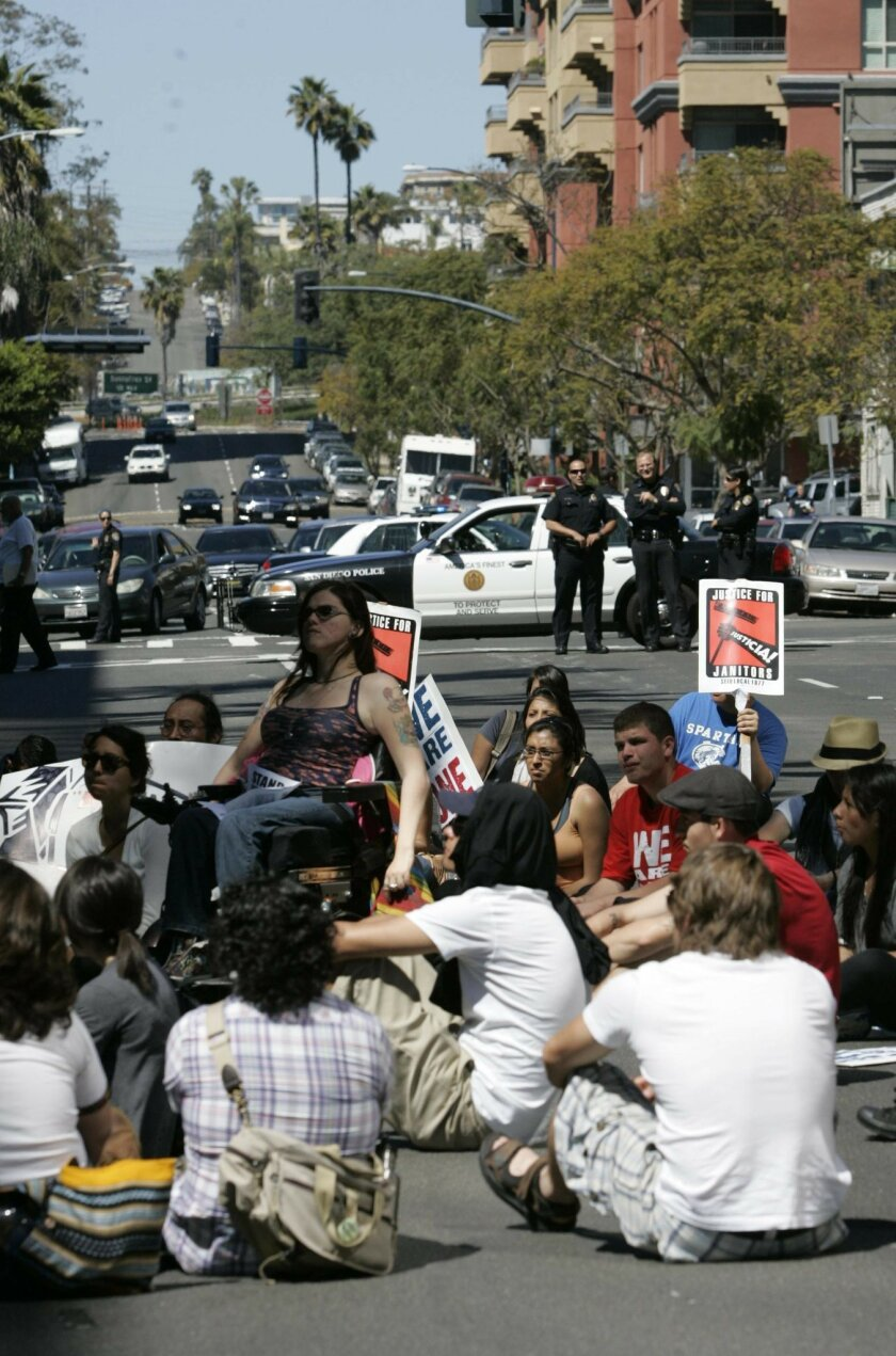 Nearly 70 students who participated in a Cesar Chavez Day march and shut down traffic on Front Street between Ash and A streets to protest budget cuts and higher student fees, among other things.
