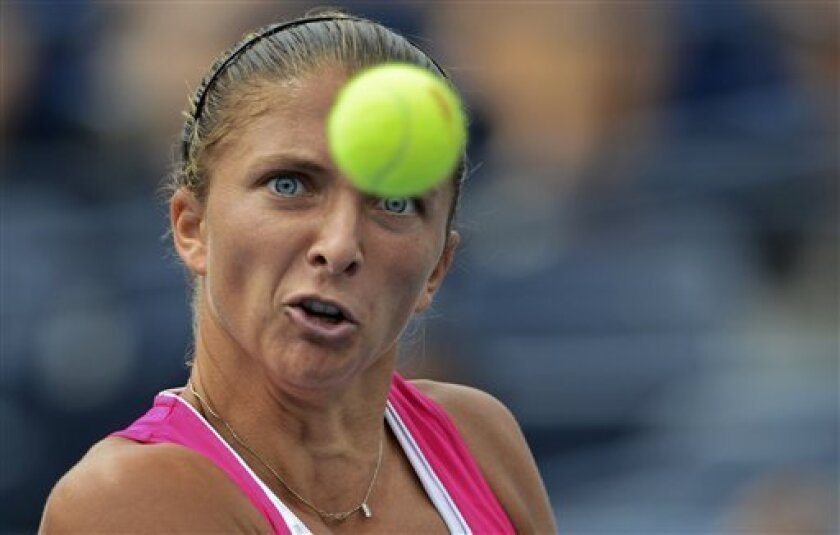Italy's Sara Errani returns a shot to Germany's Angelique Kerber in the fourth round of play at the 2012 US Open tennis tournament,  Monday, Sept. 3, 2012, in New York. (AP Photo/Henny Ray Abrams)