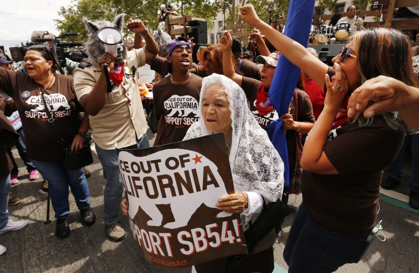 "Petra Ramirez, 79, of Fresno, joins protesters as part of the ""Caravan Against Fear,'' a coalition o"