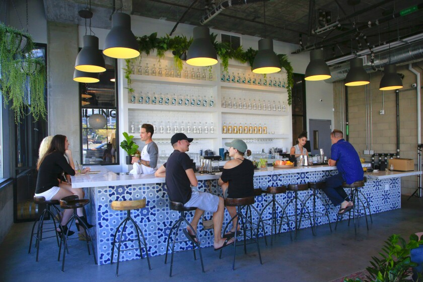 The industrial chic bar at You & Yours Distilling Co., in downtown San Diego's East Village.