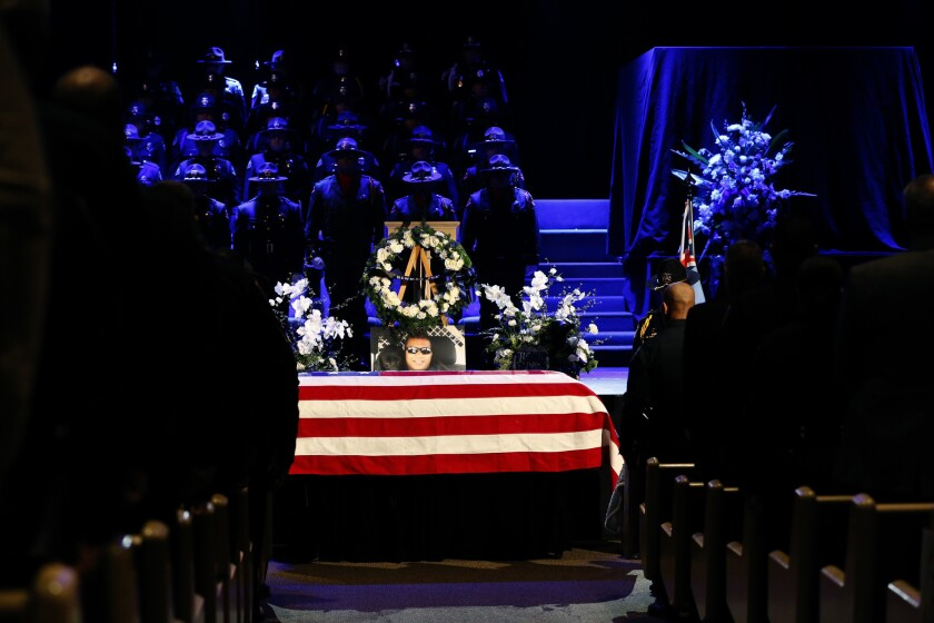 The flag-draped casket of Ronil Singh at the funeral Saturday for the slain Newman police officer.