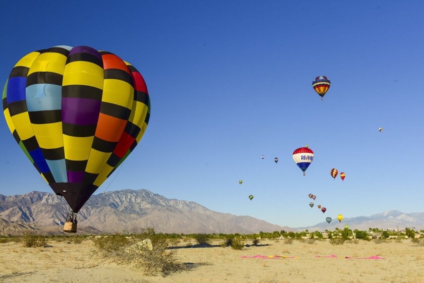 Kick back and watch balloons float in the desert sky at the Cathedral City Hot Air Balloon Festival.