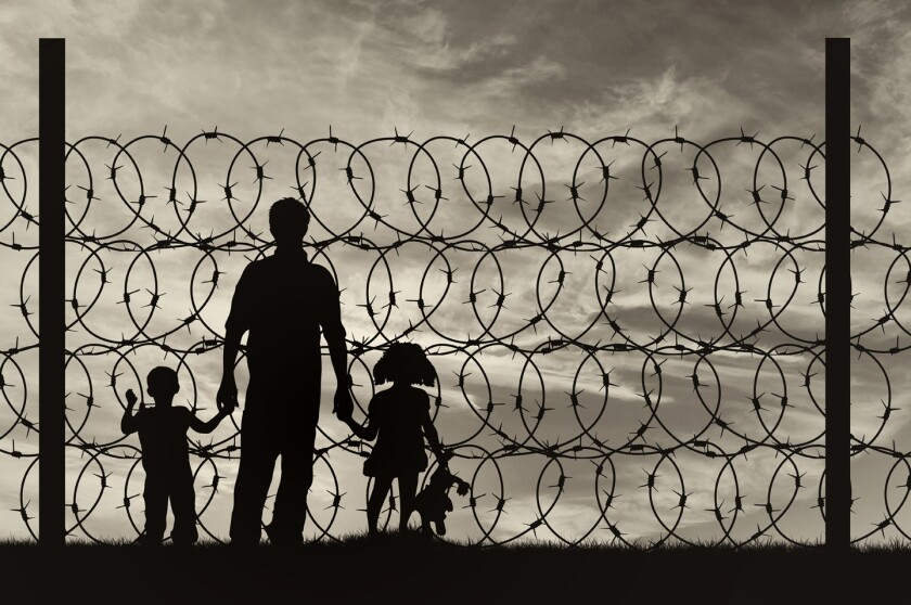Silhouette of a family with children refugees