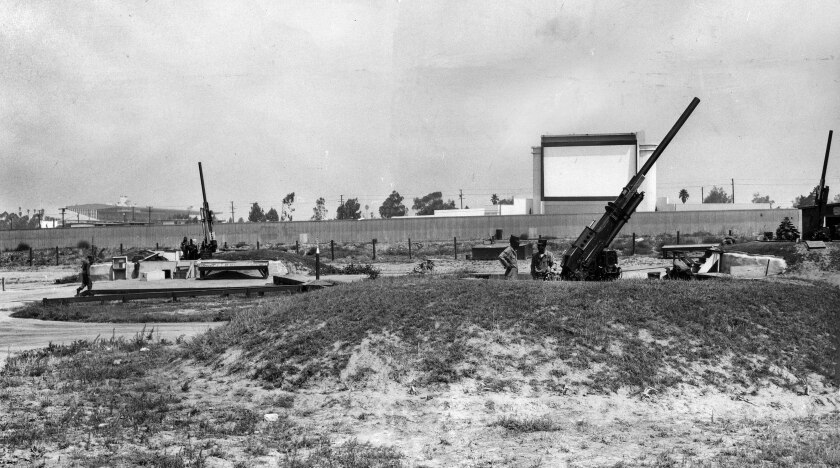 Aug. 17, 1955: Antiaircraft guns of the 77th AAA Gun Battalion in Inglewood lie in the shadow of a drive-in movie theater and Hollywood racetrack, left.