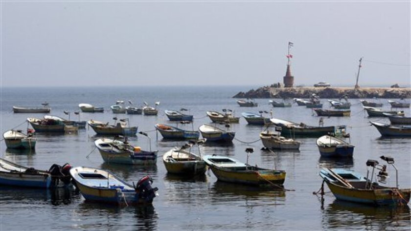 Empty fishing boats anchor in Gaza's seaport, Tuesday, June 1, 2010.  Palestinians in Gaza declared a general strike and a day of wrath following Israel's deadly naval raid on an aid flotilla bound for the blockaded Gaza Strip on Monday.(AP Photo/Hatem Moussa)