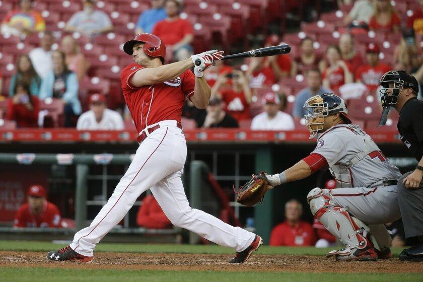 Cincinnati Reds' Adam Duvall hits the game-winning three-run home run off Washington Nationals relief pitcher Shawn Kelley eighth in the inning of a baseball game, Saturday, June 4, 2016, in Cincinnati. The Reds won 6-3. (AP Photo/John Minchillo)