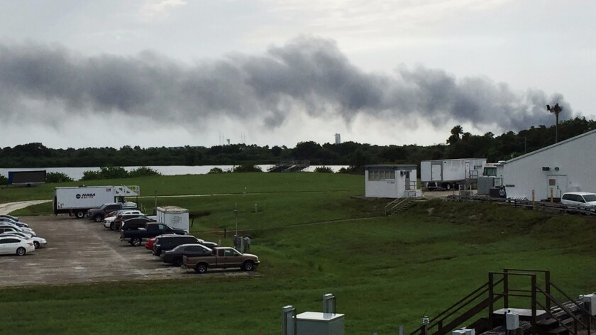 Smoke rises from a SpaceX launch site Thursday at Cape Canaveral, Fla.