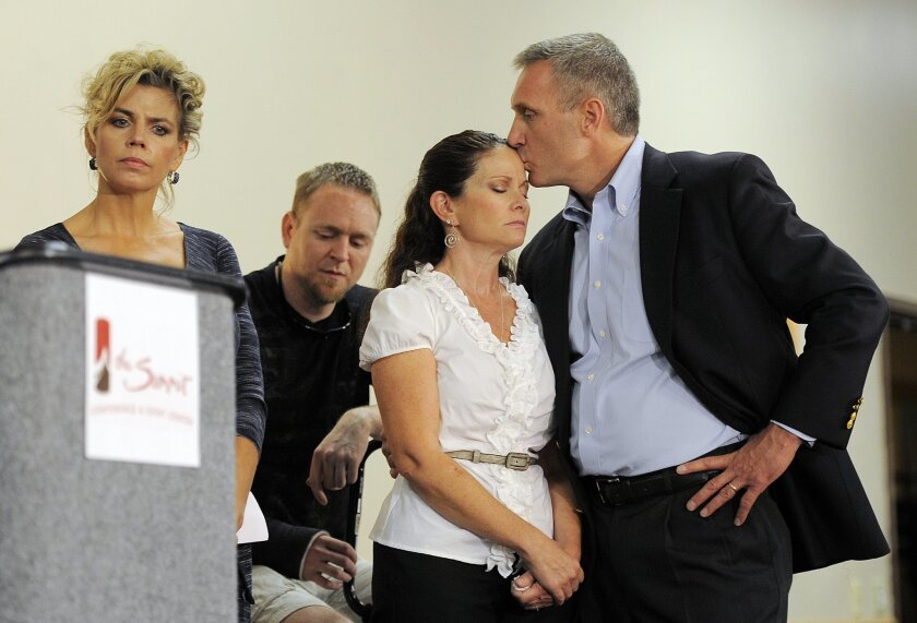 FILE - In this Aug. 28, 2012 file photo, Thomas and Caren Teves, right, whose son, Alex, was killed in the 2012 Aurora movie theatre massacre, join a news conference with families of victims of the Colorado theater shooting, in Aurora, Colo. Their son Alex, 24, had just earned a master's degree in