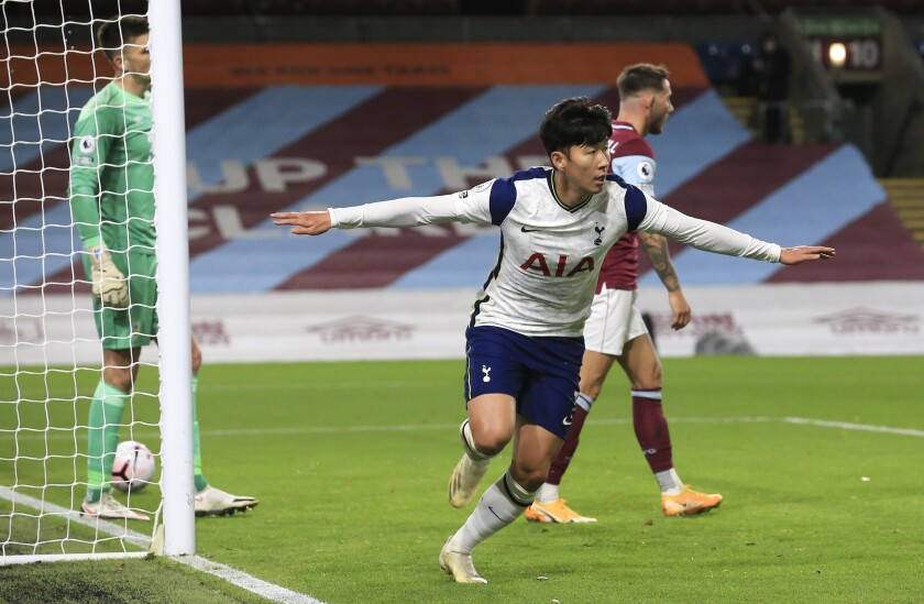Tottenham's Son Heung-min celebrates after scoring his team's first goal during the English Premier League soccer match between Burnley and Tottenham Hotspur at Turf Moor stadium, Burnley, England, Monday, Oct. 26, 2020. (Lindsey Parnaby/Pool via AP)
