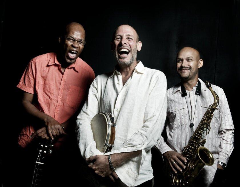 From left: Lionel Loueke, Jeff Ballard, Miguel Zenon. Photo by Andrea Boccalini