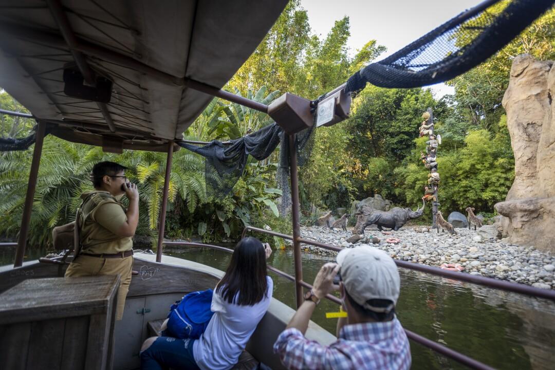 Skipper Amanda Beth Lorenzo leads the Jungle Cruise past animals on shore