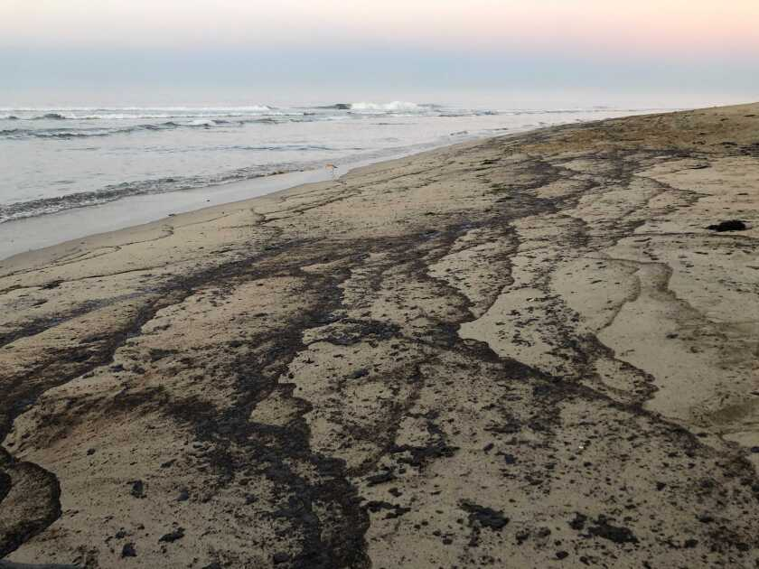 Oil washed up on Huntington Beach.
