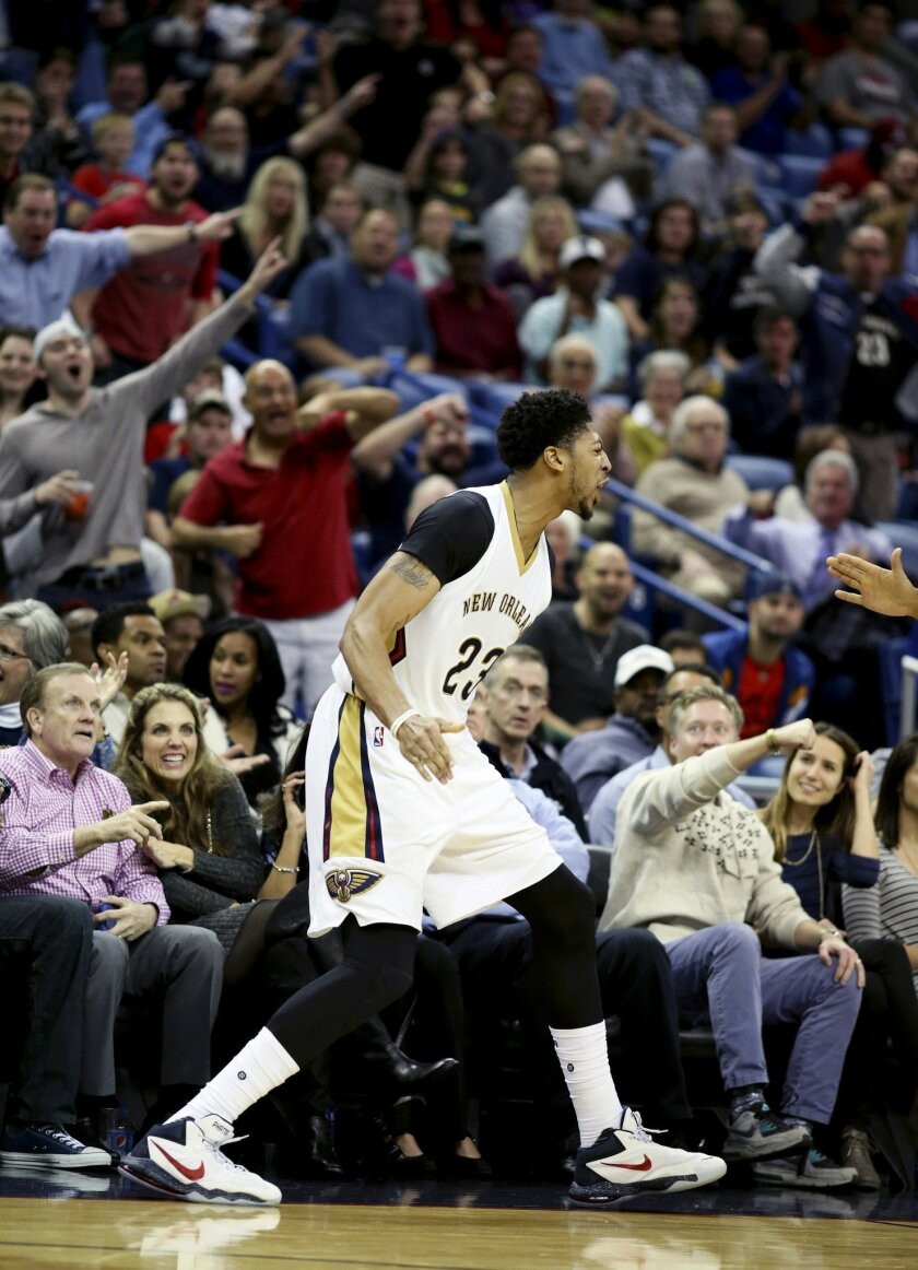 New Orleans Pelicans forward Anthony Davis celebrates during the second half of an NBA basketball game against the San Antonio Spurs in New Orleans, Friday, Nov. 20, 2015. The Pelicans won 104-90. (AP Photo/ Max Becherer)