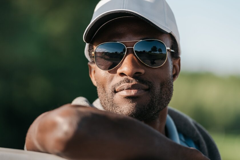 Close-up portrait of handsome african american man in cap and sunglasses