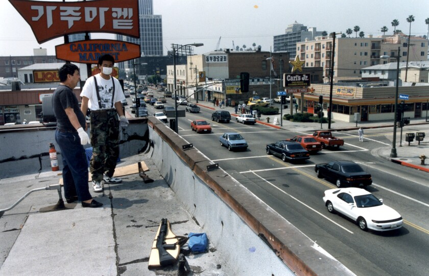 People stand on the roof of California Market in 1992